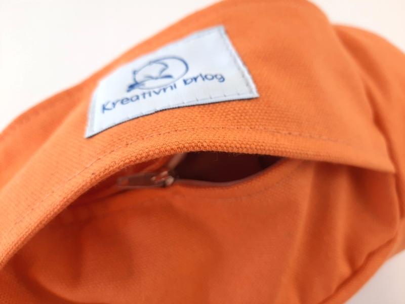 RETREAT Petra narančasti jastuk detalj